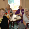 Former classmates listen to stories of their years at Regina High School. Clockwise from left, Mary Lou Hewitt Weber, Joan Schneder Crable, Marilyn McDermott Clements, Precious Blood Sister Alice Scholkotte and Mary Kuntz Smiley. Sister Alice is a 1954 Regina graduate.