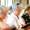 From left, Loretta Riley Luers, Barb Powers and Pat Martin Benken participate in Mass as part of the reunion. Precious Blood Sister Katie Lett, who was class president, hosted the reunion.