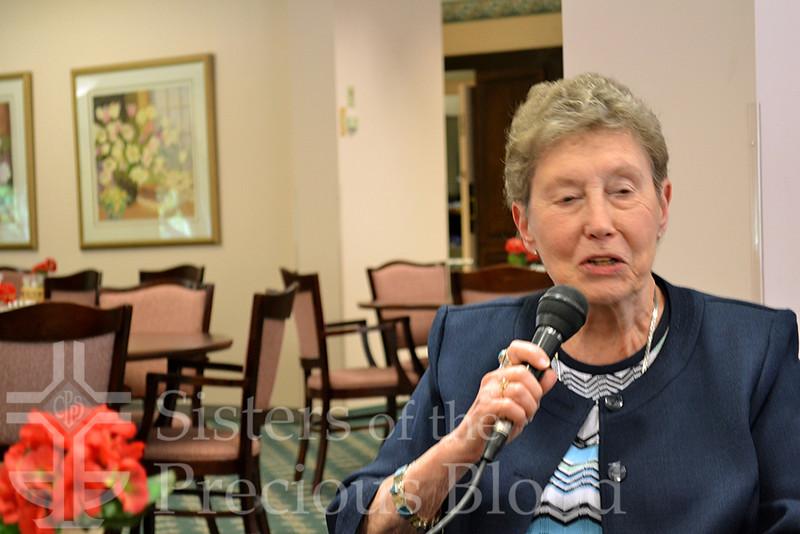 Ann Burwinkel Murray speaks during the reunion.