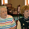 Mary Theresa Oaks Shea and Pat Martin Benken listen to a former classmate during the reunion.