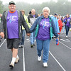 Ray and Sharon Lashua, both cancer survivors of Gardner, walk the survivor's parade to kick off the start of the American Cancer Society's Relay For Life at Mount Wachusett Community College on Friday evening. SENTINEL & ENTERPRISE / Ashley Green