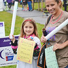 Sandra Bushey, of Gardner (right), and daughter Kaylynn Wotton, 7, sell glow sticks at the Relay For Life at Mount Wachusett Community College on Friday evening. Bushey is a recent graduate of the MWCC Nursing program. SENTINEL & ENTERPRISE / Ashley Green