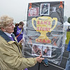 Carolyn Emery, of Westminster, walks the Relay For Life on Friday evening carrying a poster board showcasing photos of 15-year-old Fitchburg teen Sam Buscemi.  Sam is currently battling Leukemia at Boston Children's Hospital. Carolyn herself, is a cancer survivor. SENTINEL & ENTERPRISE / Ashley Green