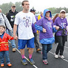 The survivor's parade kicks off the start of the American Cancer Society's Relay For Life at Mount Wachusett Community College on Friday evening. Andrew Belkey, Jack Meaney, along with survivors Susan Belkey and Marylou Gilman, of Winchendon, walk the survivors parade. SENTINEL & ENTERPRISE / Ashley Green
