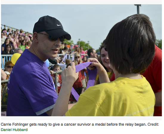 "Carrie Fohlinger gets ready to give a cancer survivor, Damian Esposito, a medal before the relay began.<br /> Photo Credit: Daniel Hubbard - Wayne Patch <br /> <br /> <a href=""http://wayne.patch.com/articles/hundreds-walk-to-raise-money-for-cancer-research#photo-9911530"">http://wayne.patch.com/articles/hundreds-walk-to-raise-money-for-cancer-research#photo-9911530</a>"