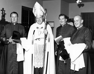 The investiture of Father R. Donald Kiernan, far right, to the title of monsignor by Archbishop Thomas A. Donnellan, second from left, took place on Oct. 10, 1969 at the Cathedral of Christ the King, Atlanta.