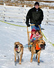 Musher Rick Skoglund, of Perry Greene Kennel in Waldoboro, ME, and his Chinooks, give a dogsled ride to Annika (rear) & Eliza Mahoney, of Madison, NH, during The Remick Country Doctor Museum and Farm's annual Ice Harvesting and Winter Carnival event, which was held on Saturday, February 13, 2010, in Tamworth, NH.