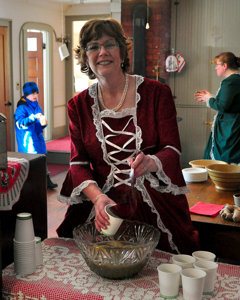 Jane Fryburg, of North Sandwich, and an educator at The Remick Country Doctor Museum & Farm in Tamworth, serves some mulled cider in the kitchen of The Captain Enoch Remick House, during the Victorian Christmas event, which was held on Saturday, December 12th, 2009.