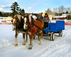 Wayne Phillips and Lindsey Peterson, of The Remick Country Doctor Museum & Farm in Tamworth, NH, prepare to take visitors on a horse drawn wagon ride during the Victorian Christmas event held Saturday Dec. 12th, 2009.
