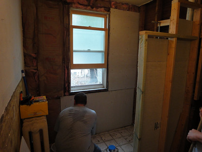 New insulation is in and Scott screwing in some of the new wallbaord.