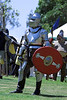 Medieval knight in full armor on the field of battle