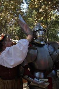 Adjusting the armor.