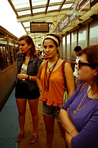 The lovely girls wait for the L.