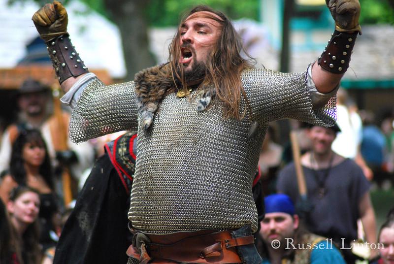 Triumphant<br /> A knight in chain mail defeats his foes. Scarborough Rennaissance Fair, Waxahachie, Texas.
