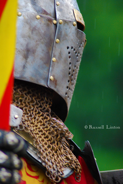Reckoning<br /> Knight in full armor prepares to joust despite the steady down pour. Scarborough Rennaissance Fair, Waxahachie, Texas.