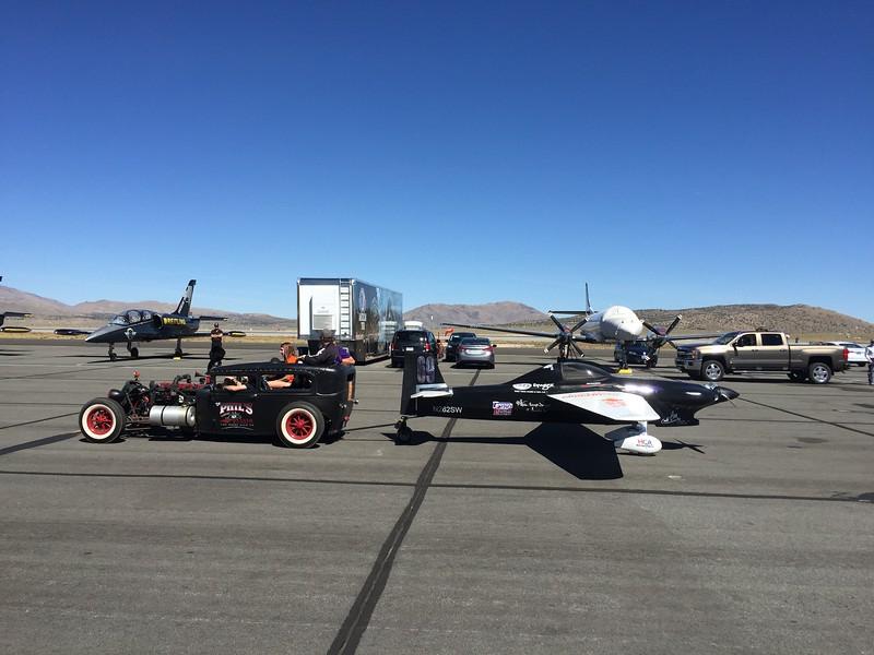 Rat Rod pit vehicle towing an F-1 race plane.