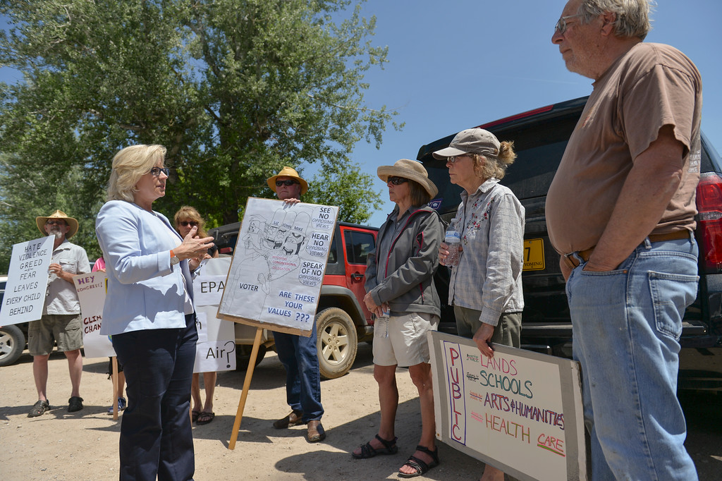 Justin Sheely | The Sheridan Press<br /> U.S. Rep. Liz Cheney, R-Wyoming, visits with protesters before going to her speaking engagement at the Republican Women of Sheridan County scholarship fundraiser Thursday at the Big Horn Smokehouse in Big Horn. Real Resistance Wyoming of Sheridan organized the protest against Rep. Cheney and government cuts to the Environmental Protection Agency. Cheney came to speak at the fundraiser, which provides scholarships to local women republican college students.