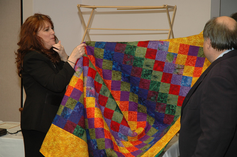 Kim Wyman, Thurston County Auditor with quilt donated by her mother for the fund raising auction.<br /> LD08-002