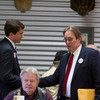 Brad McCullouch and Scott Monroe greet one another at the candidate forum.