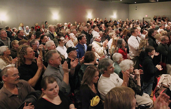 Record-Eagle/Keith King<br /> Attendees applaud as Republican presidential candidate Herman Cain talks Thursday, November 10, 2011 at Streeters in Traverse City.