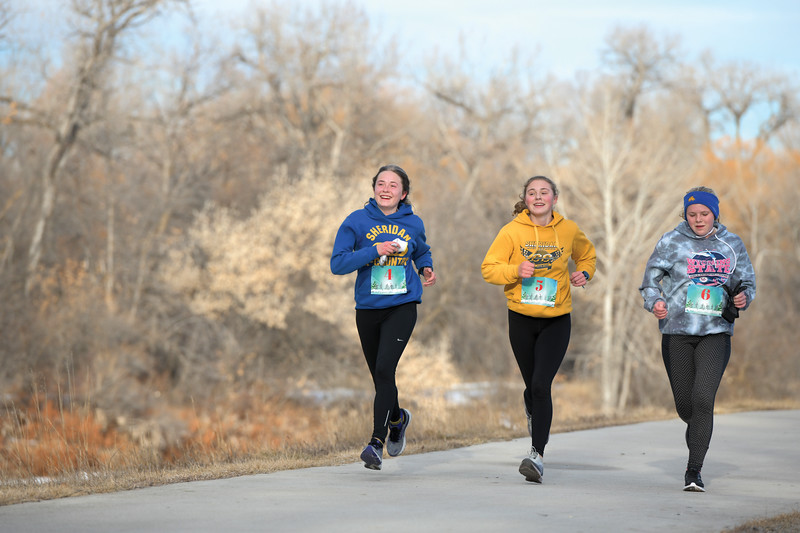 Matthew Gaston | The Sheridan Press<br>Sheridan tracksters, from left, Sylvia Brown, Katie Turpin and Dana Weatherby are all smiles as they approach the finish line during the Resolution Run 5K Saturday, Jan. 4, 2020.