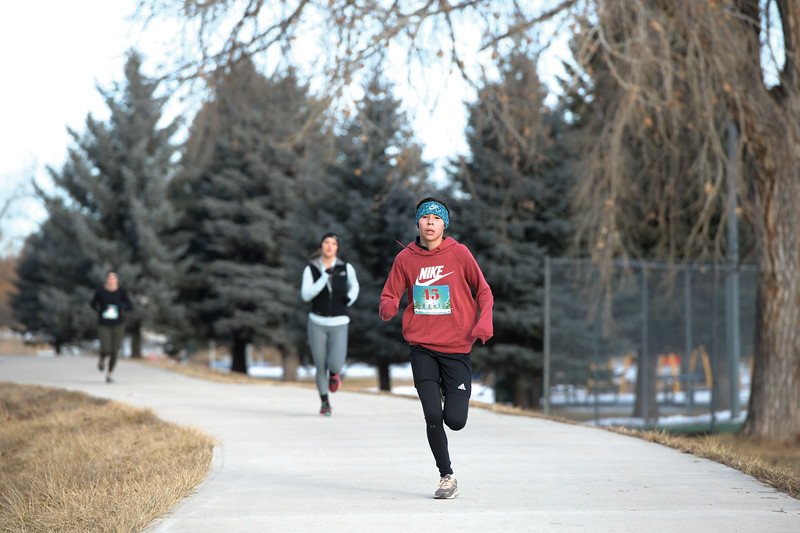 Matthew Gaston | The Sheridan Press<br>Mariah Aragon, 13, quickens her pace for a strong finish during the Resolution Run 5K at Thorne-Rider Park Saturday, Jan. 4, 2020.