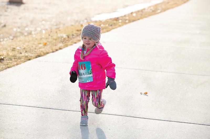 Matthew Gaston | The Sheridan Press<br>Two-year-old Austin VanDyke runs really fast during the Resolution Run 5K at Thorne-Rider Park Saturday, Jan. 4, 2020.