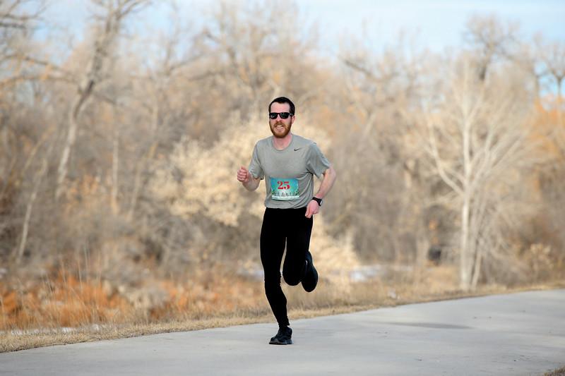 Matthew Gaston | The Sheridan Press<br>James Grueser grits his teeth as he races to the finish line during the Resolution Run 5K Saturday, Jan. 4, 2020. Grueser was the first to finish this years Resolution Run 5K.