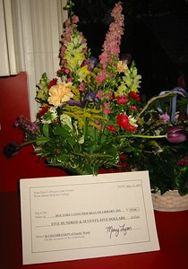 Flowers and symbolic check for Holyoke Consumer Health Library, Inc.