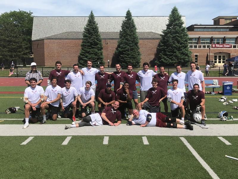 Team Photo of the alumni lacrosse game on the football truf