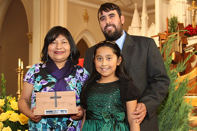 Gloria Vazquez, left, 2013 Father Bruce Wilkinson Founders Award recipient, stands with her husband Eleazar and her nine-year-old daughter Elizabeth. Vazquez and her family attend St. Oliver Plunkett Church, Snellville, where she serves as a catechist in the Adult Education Program for the Hispanic Community and an Extraordinary Minister of the Eucharist.