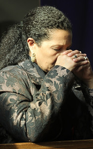 Maria Almeida of St. Oliver Plunkett Church, Snellville, prays during the Liturgy of the Eucharist.