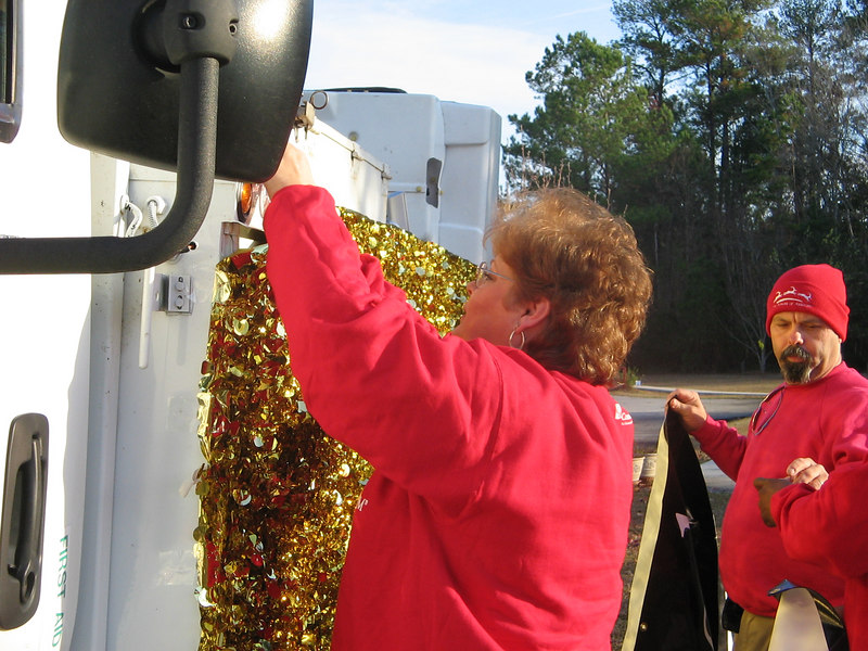 To get the foil on the truck the team used magnet tape. To get the banners on the truck they poked holes in the foil to attach suction cups. The banner's grommets attached to the hook on the cups.