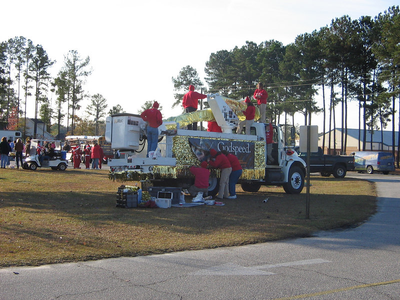 Coastal Electric employees, their spouses, and children came to help decorate the truck.