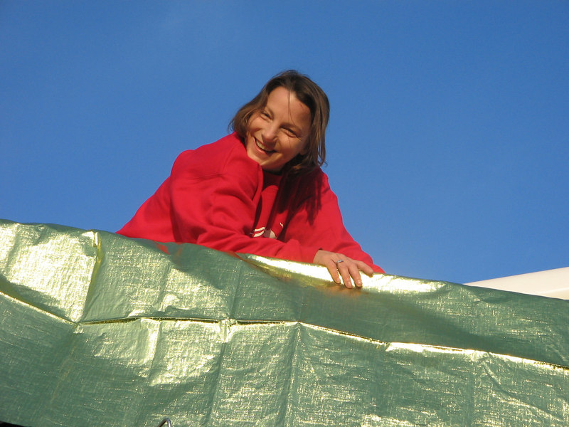 Sharon pauses for a second while wrapping the boon on the bucket truck.