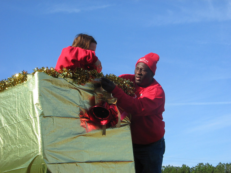 Sharon and Pharris attach the red bells to the bucket.