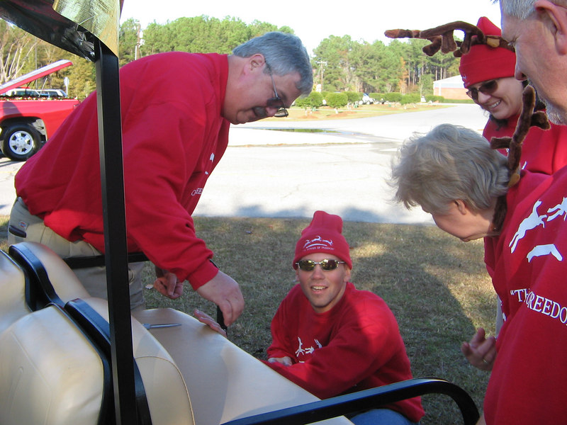 Whit, Doug, Michelle, Gloria and Lee (Gloria's husband) discuss decorating the golf cart.