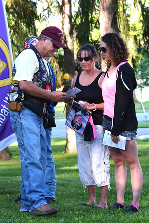 "Debbie Blank | The Herald-Tribune<br /> ""We will never forget Chad,"" a Ride to Remember participant vowed as he gave a rose to Keith's mother during the somber ceremony."