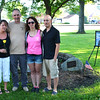 Debbie Blank | The Herald-Tribune<br /> Sgt. Chad Keith's mother and stepfather, Kim (from left) and Mark Hitzges, Noblesville, and daughter Nikki Glutz, Cincinnati, and her husband, Joe, stand near the late Batesville High School graduate's portrait and a tree planted in his memory at Liberty Park. Joe and Chad served together in the U.S. Army 82nd Airborne Division in Iraq.