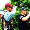 "Debbie Blank | The Herald-Tribune<br /> Ride co-founder Ed Schmidt, Napoleon, salutes as Kerry Eckstein, St. Leon, plays ""Taps."" Another bugler on the other side of the gathering echoed a response, then the bagpipers closed the program with music that faded into the countryside."