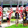 Debbie Blank | The Herald-Tribune<br /> Hoosiers of all ages held flags at the Liberty Park ceremony.