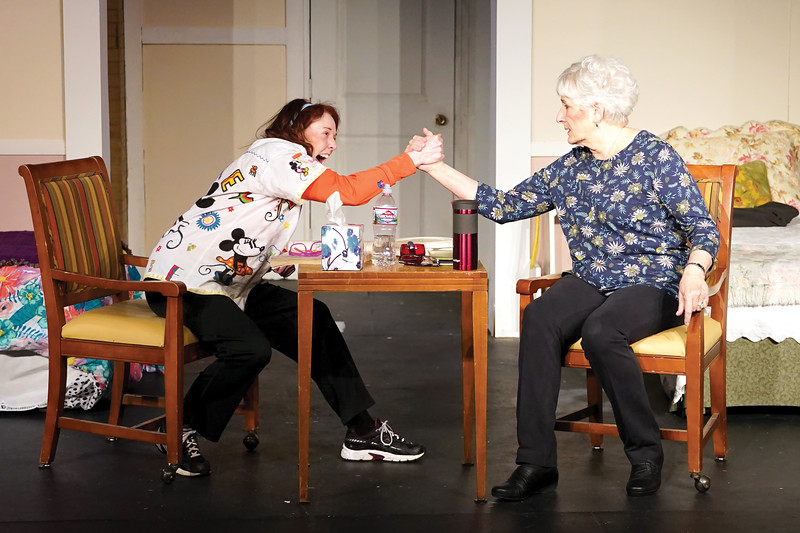 Matthew Gaston | The Sheridan Press<br>Marilyn (Allyson Harvey), left, makes a bet with Abby (Sharon Bedard), right. If Marilyn wins, she gets the bed by the window. If Abby wins, Marilyn has to move out.