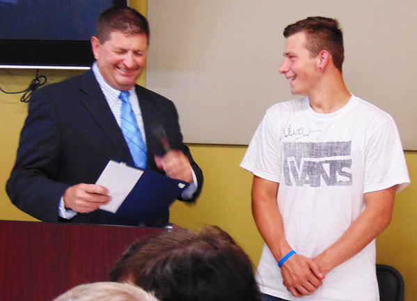 "Debbie Blank | The Herald-Tribune   <br /> Chamber President Phillip Hart (left) introduced Osgood snowboarder Chris Perdue, who captured gold in the 2017 Special Olympics World Winter Games second men's division of the advanced giant slalom in Austria. The South Ripley High School junior received a standing ovation and certificate. Hart noted, ""What he's done for Ripely County – and continues to do – means a lot to us."""