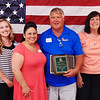 Owner George Gillman (center) accepts celebrates the honor with Milan and Versailles area employees (from left) Jon Strautman, Kristen Armbrecht, Kristina Pope, Patty Riebsomer and Michele Demaree.