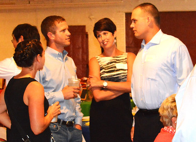 Debbie Blank | The Herald-Tribune Coalition Treasurer Kevin Campbell (from right) and wife Natasha invited Jeremy and Elizabeth Miller to be their table guests.