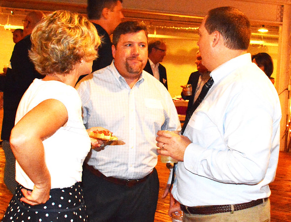 Debbie Blank | The Herald-Tribune<br /> Bill Belew (from right) of Ripley County Court Services, Todd Russell of Milan Christian Church and Lindsay Belew visited as the 240 attendees gathered at RomWeber Marketplace.