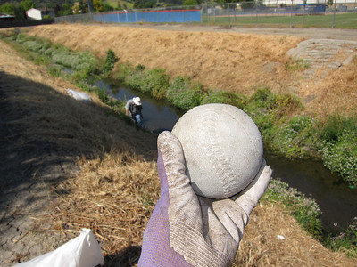As another volunteer picks up more debris, I find a large rubber ball.