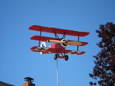 One of the neighbors adjoining the creek had this cool World War 1 Fokker Dr1 Red Baron triplane wind vane! How cool is that? I used to build WW1 plane models.