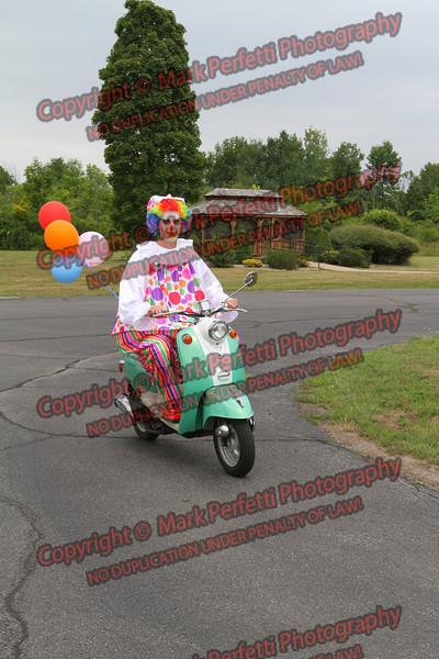 BoBo the clown takes a ride