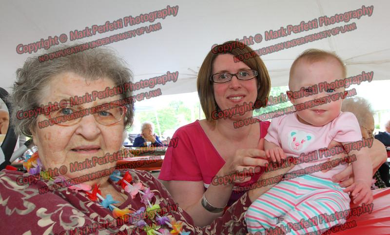 Resident Dorthy Lachanski sits with her relitives Laura Lachanski and great grandaughter Pauline Lachanski